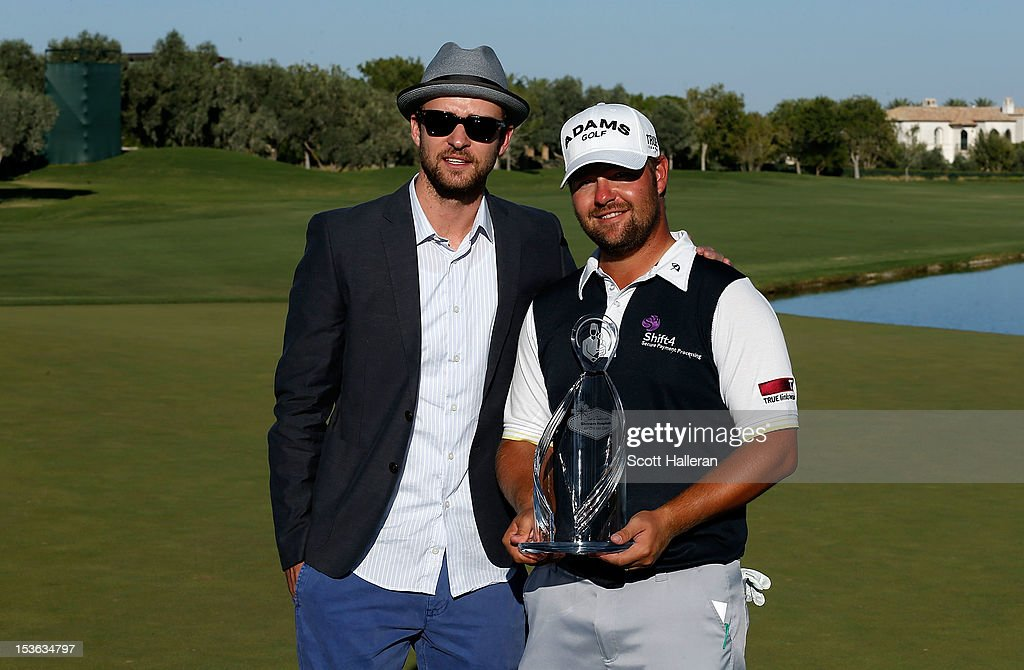 Ryan Moore (R) poses with tournament host Justin Timberlake and the trophy after winning the Justin Timberlake Shriners Hospitals for Children Open at TPC Summerlin on October 7, 2012 in Las Vegas, Nevada.
