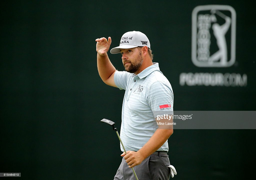Ryan Moore reacts after putting on the 18th green during the final round of the Valspar Championship at Innisbrook Resort Copperhead Course on March...