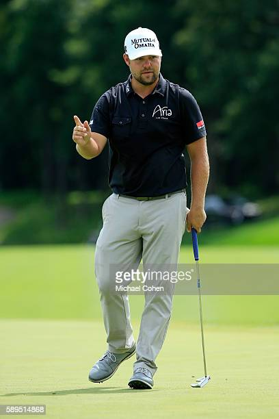 Ryan Moore reacts to his shot on the eighth hole during the final round of the John Deere Classic at TPC Deere Run on August 14 2016 in Silvis...