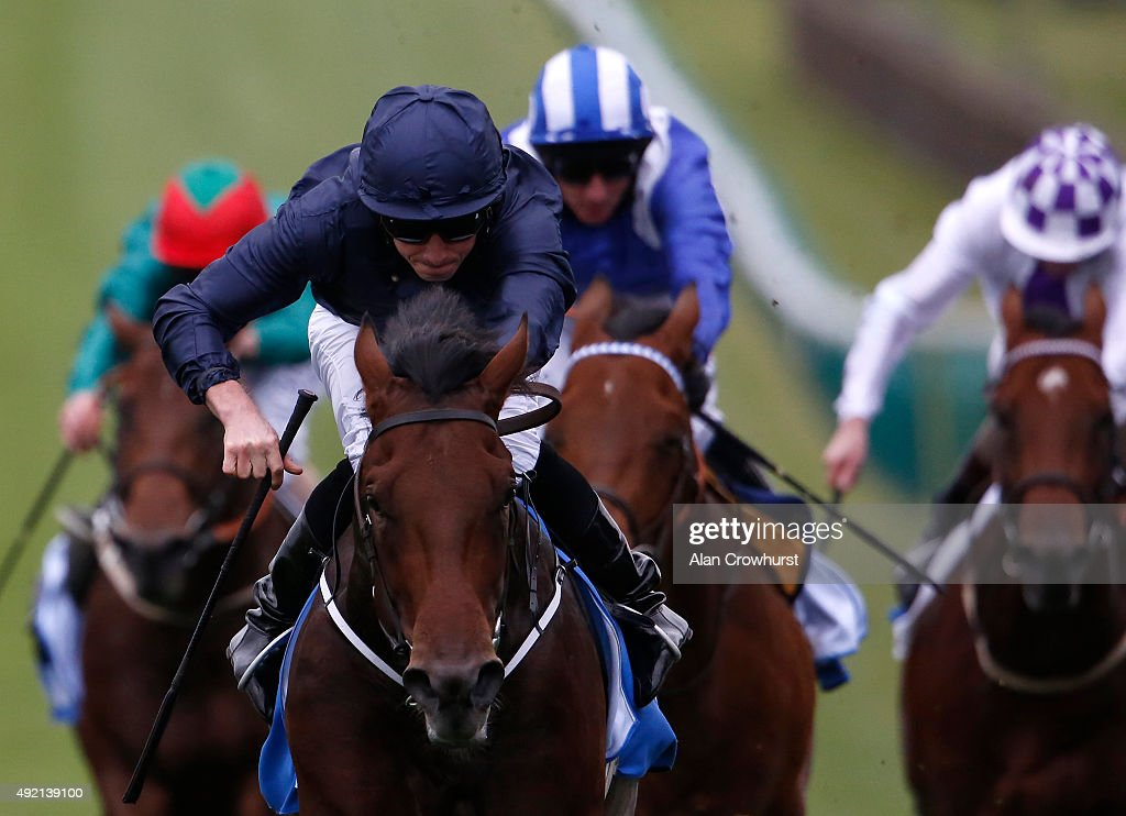 Ryan Moore riding Air Force Blue win The Dubai Dewhurst Stakes at Newmarket racecourse on October 10 2015 in Newmarket England