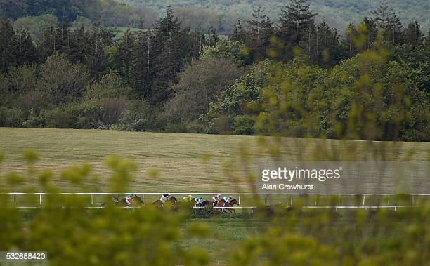 Ryan Moore riding Atone lead the way before winning The Breeders Backing Racing EBF Naiden Fillies' Stales at Goodwood racecourse on May 19 2016 in...