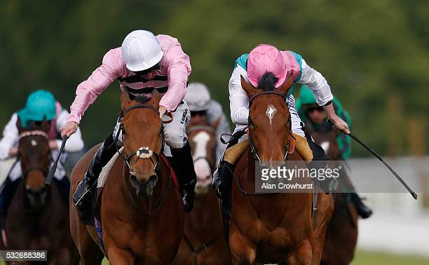 Ryan Moore riding Atone win The Breeders Backing Racing EBF Naiden Fillies' Stales at Goodwood racecourse on May 19 2016 in Chichester England
