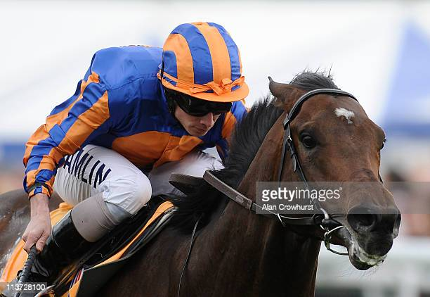 Ryan Moore riding Await The Dawn win the Betfair Huxley Stakes at Chester racecourse on May 05 2011 in Chester England