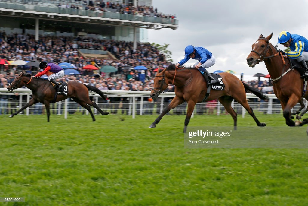 Ryan Moore riding Dartmouth (L) win The Betway Yorkshire Cup at York racecourse on May 19, 2017 in York, England.
