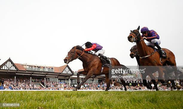 Ryan Moore riding Dartmouth win The Boodles Diamond Ormonde Stakes from Wicklow Brave at Chester racecourse on May 6 2016 in Chester England
