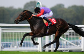 Ryan Moore riding Dartmouth win The British Stallion Studs/Exhibition News EBF Maiden Stakes at Sandown racecourse on September 17 2014 in Esher...