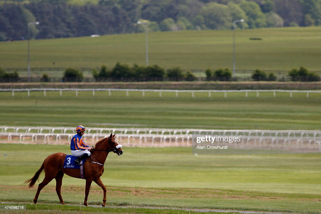 Ryan Moore riding Giovanni Canaletto make their way to the start at Curragh racecourse on May 24 2015 in Kildare Ireland