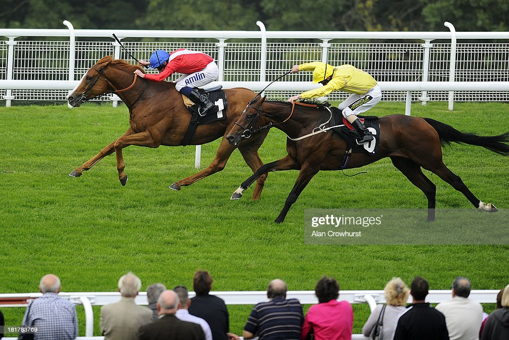 Ryan Moore riding Gospel Choir (L) win The Santa Maria Foodservice Stakes at Goodwood racecourse on September 25, 2013 in Chichester, England.