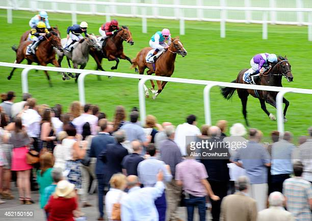 Ryan Moore riding Heartbreak Hero win The Betdaq £25 No Lose Free Bet EBF Stallion Maiden Stakes at Windsor racecourse on July 14 2014 in Windsor...