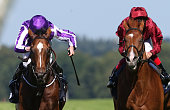 Ryan Moore riding Highland Reel win The King George VI And Queen Elizabeth Stakes from Wings Of Desire and Frankie Dettori at Ascot Racecourse on...