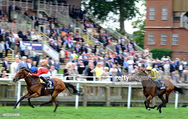 Ryan Moore riding Integral win The Qipco Falmouth Stakes at Newmarket racecourse on July 11 2014 in Newmarket England