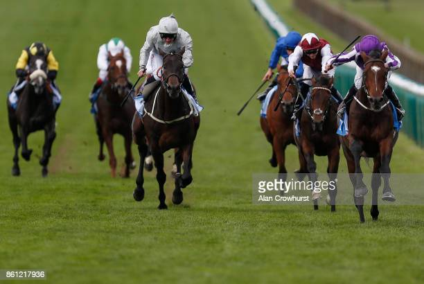 Ryan Moore riding Kew Gardens win The Godolphin Flying Start Zetland Stakes at Newmarket racecourse on October 14 2017 in Newmarket United Kingdom