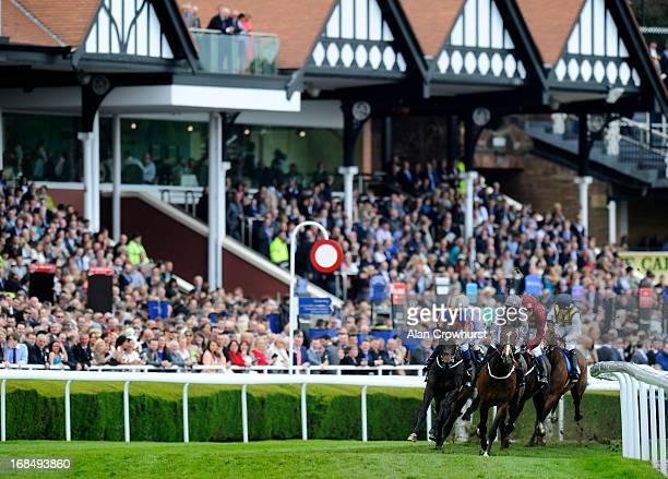 Ryan Moore riding Magician turn away from the stands before winning the BetVictor com Dee Stakes at Chester racecourse on May 10 2013 in Chester...
