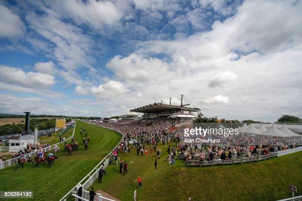 Ryan Moore riding Master The World ease down after winning The Betfred Mile Handicap Stakes on day four of the Qatar Goodwood Festival at Goodwood...