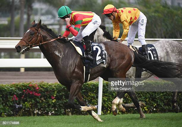 Ryan Moore riding Maurice from Japan defeats Christophe Soumillon riding Giant Treasure in Race 7 The Longines Hong Kong Mile during the Hong Kong...