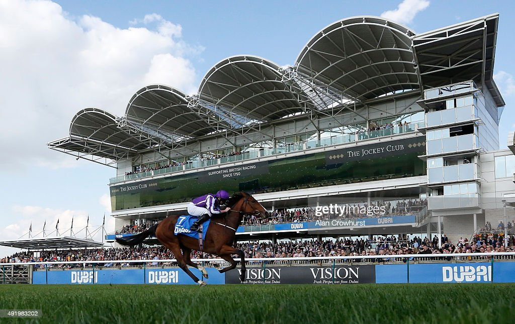 Ryan Moore riding Minding win The Dubai Filies' Mile at Newmarket racecourse on October 09 2015 in Newmarket England