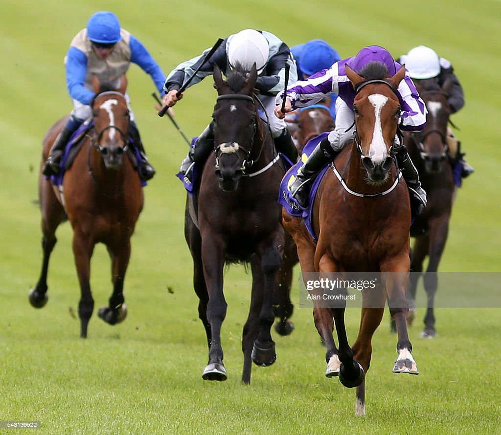 <a gi-track='captionPersonalityLinkClicked' href=/galleries/search?phrase=Ryan+Moore+-+Jockey&family=editorial&specificpeople=11563713 ng-click='$event.stopPropagation()'>Ryan Moore</a> riding Minding win The Sea The Stars Pretty Polly Stakes at Curragh Racecourse on June 26, 2016 in Kildare, Ireland.