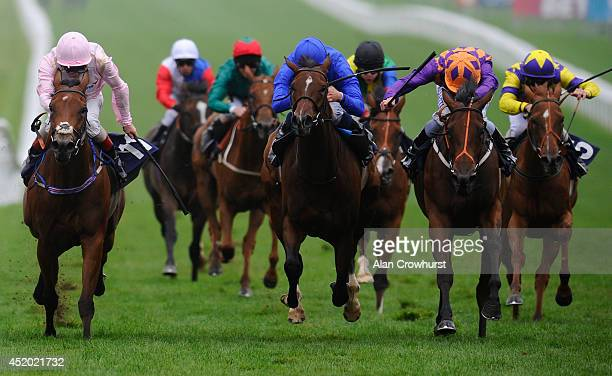 Ryan Moore riding Nakuti win The Price Bailey EBF Stallions Fillies' Handicap Stakes at Newmarket racecourse on July 11 2014 in Newmarket England