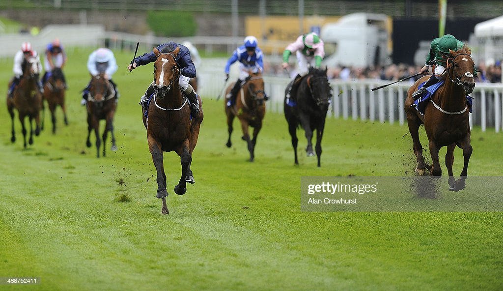 Ryan Moore riding Orchestra (C) win The MBNA Chester Vase from Romsdal (R) at Chester racecourse on May 08, 2014 in Chester, England.