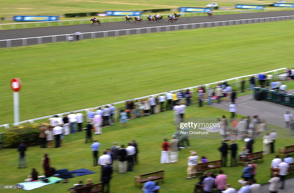 Ryan Moore riding Panda Spirit win The Leonard Curtis British Stallion Studs EBF Maiden Fillies' Stakes at Kempton Park racecourse on July 02, 2014 in Sunbury, England.