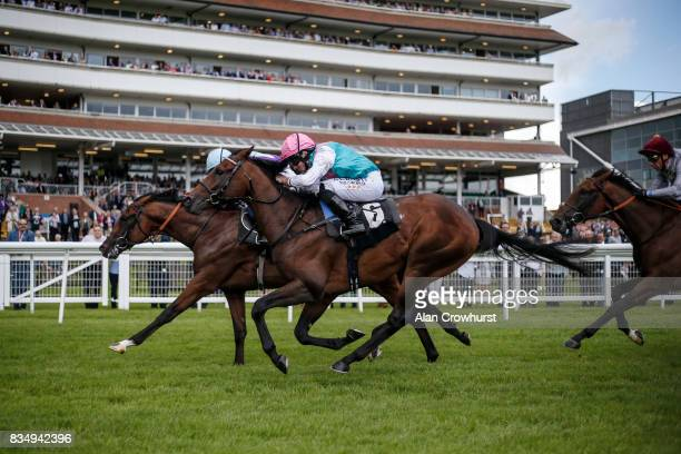 Ryan Moore riding Purser win The Don Deadman Memorial EBF Maiden Stakes at Newbury racecourse on August 18 2017 in Newbury England