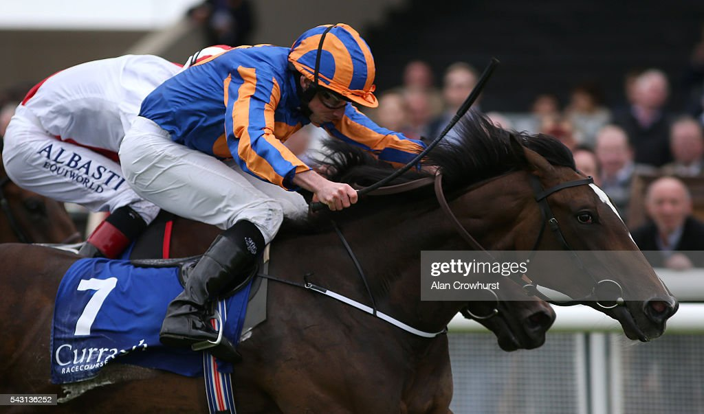 <a gi-track='captionPersonalityLinkClicked' href=/galleries/search?phrase=Ryan+Moore+-+Jockey&family=editorial&specificpeople=11563713 ng-click='$event.stopPropagation()'>Ryan Moore</a> riding Roly Poly win The Grangecon Stud Stakes at Curragh Racecourse on June 26, 2016 in Kildare, Ireland.