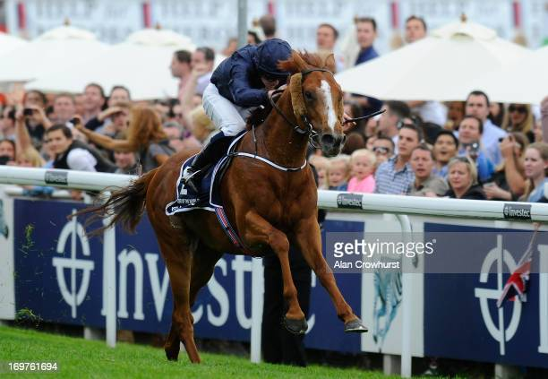 Ryan Moore riding Ruler Of The World win The Investec Derby at Epsom racecourse on June 01 2013 in Epsom England