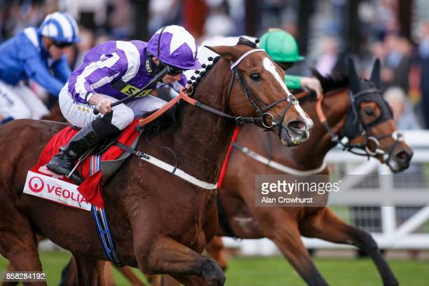Ryan Moore riding Shady McCoy win The Veolia Handicap Stakes at Ascot racecourse on October 6 2017 in Ascot United Kingdom