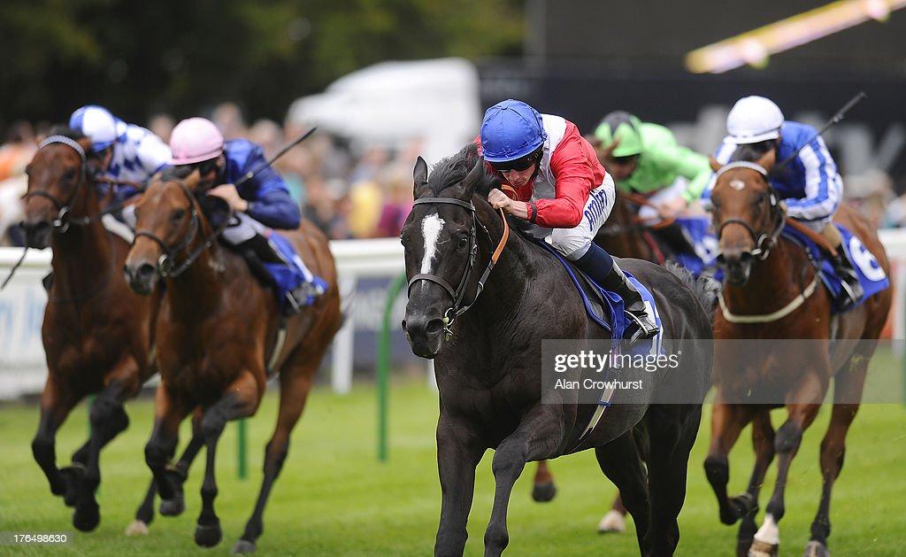 Ryan Moore riding Showpiece win The British Stallion Studs EBF Molson Coors Maiden Stakes at Salisbury racecourse on August 14, 2013 in Salisbury, England.