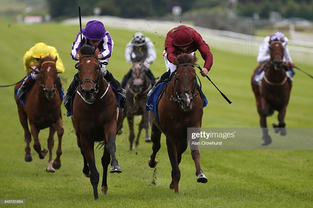 <a gi-track='captionPersonalityLinkClicked' href=/galleries/search?phrase=Ryan+Moore+-+Jockey&family=editorial&specificpeople=11563713 ng-click='$event.stopPropagation()'>Ryan Moore</a> riding <a gi-track='captionPersonalityLinkClicked' href=/galleries/search?phrase=Sir+Isaac+Newton&family=editorial&specificpeople=79182 ng-click='$event.stopPropagation()'>Sir Isaac Newton</a> (2L) win The Finlay Volvo International Stakes at Curragh Racecourse on June 26, 2016 in Kildare, Ireland.