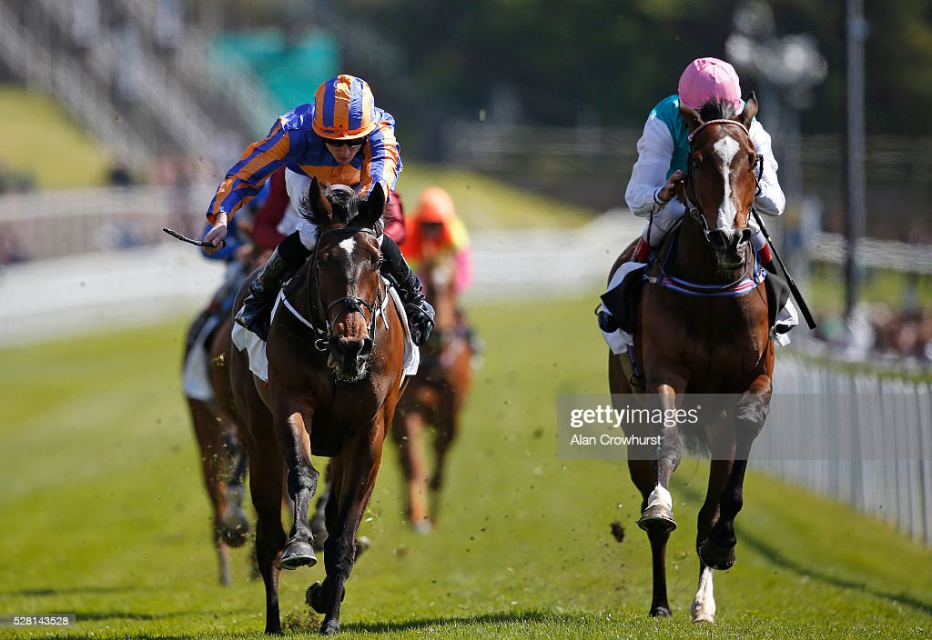 Ryan Moore riding Somehow (L) win The Arkle Finance Cheshire Oaks from Moorside (R) at Chester racecourse on May 4, 2016 in Chester, England.