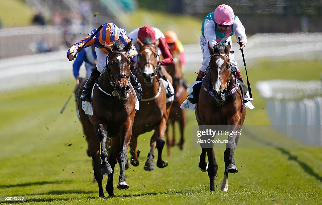 <a gi-track='captionPersonalityLinkClicked' href=/galleries/search?phrase=Ryan+Moore+-+Jockey&family=editorial&specificpeople=11563713 ng-click='$event.stopPropagation()'>Ryan Moore</a> riding Somehow (L) win The Arkle Finance Cheshire Oaks from Moorside (R) at Chester racecourse on May 4, 2016 in Chester, England.