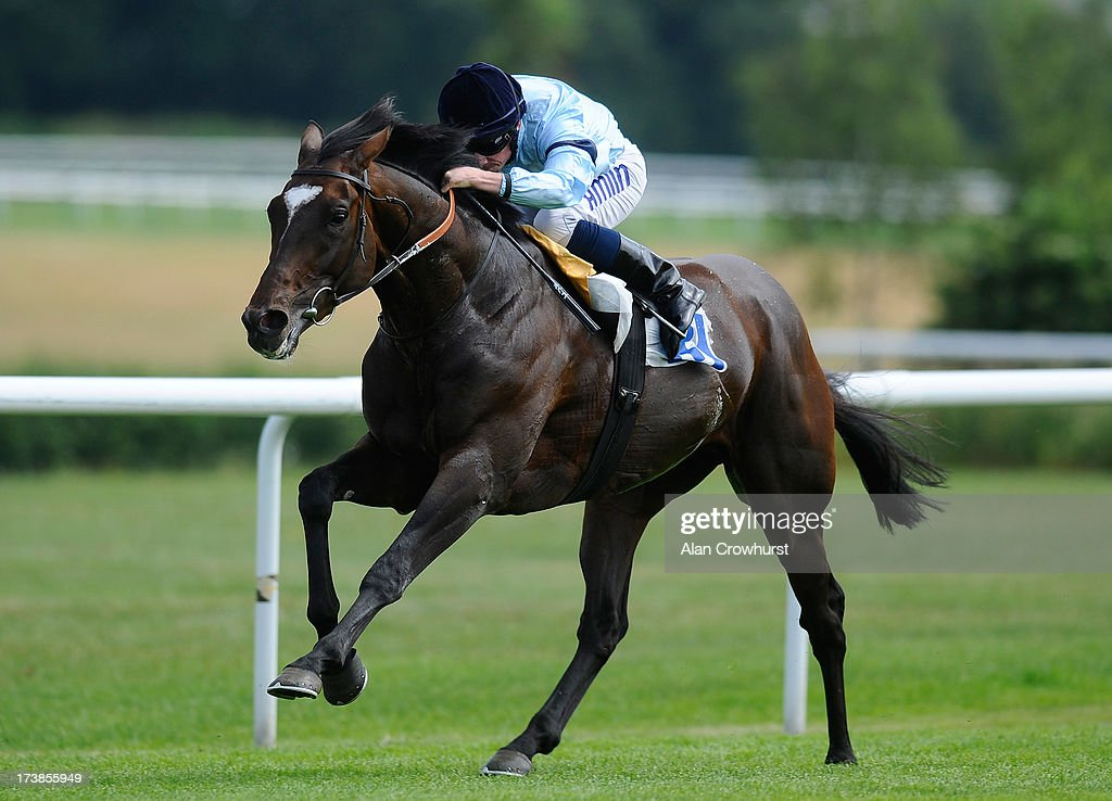 Ryan Moore riding Telescope win The At The Races Sky 415 Conditions Stakes at Leicester racecourse on July 18, 2013 in Leicester, England.