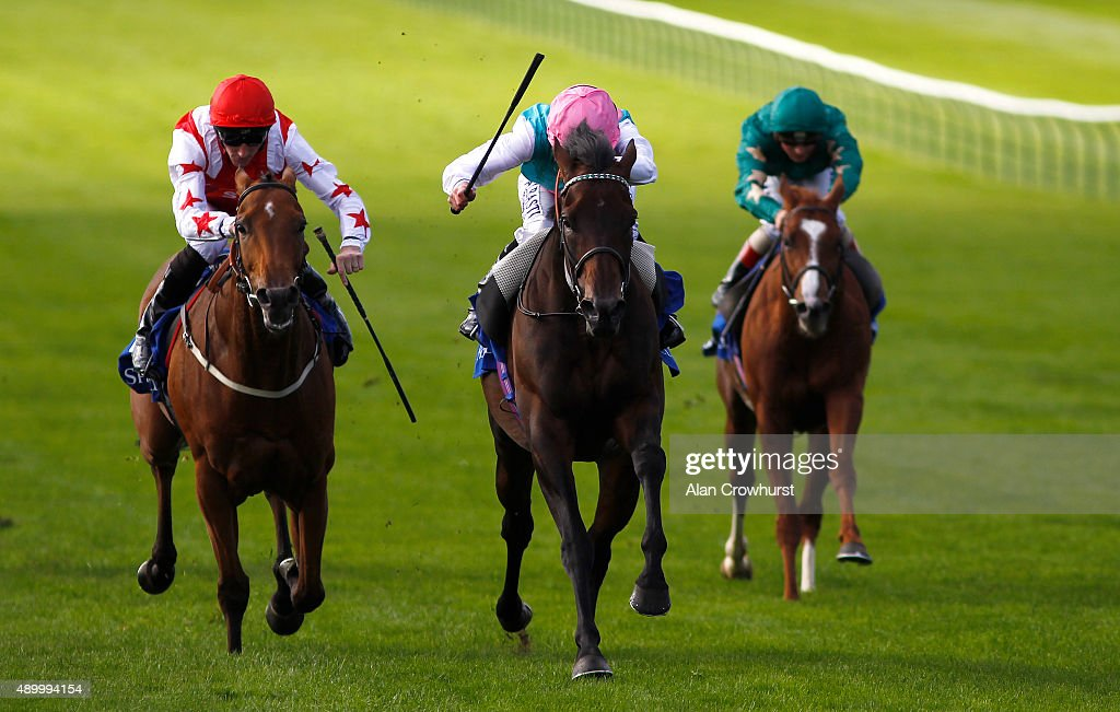 Ryan Moore riding Time Test win The Shadwell Joel Stakes at Newmarket racecourse on September 25 2015 in Newmarket England