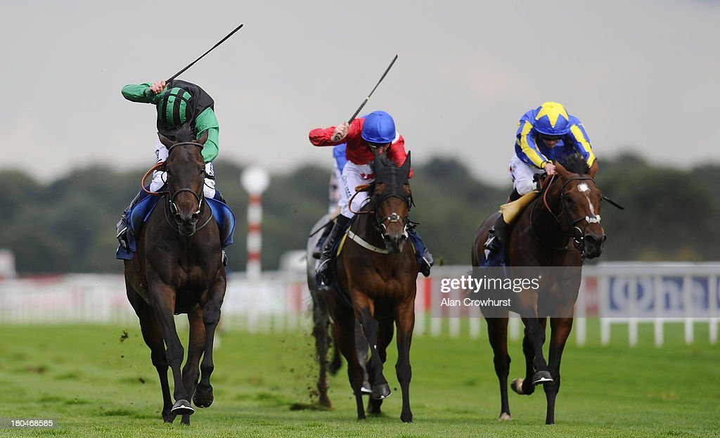 Ryan Moore riding Times Up (L) win The Speedy Services Doncaster Cup at Doncaster racecourse on September 13, 2013 in Doncaster, England.