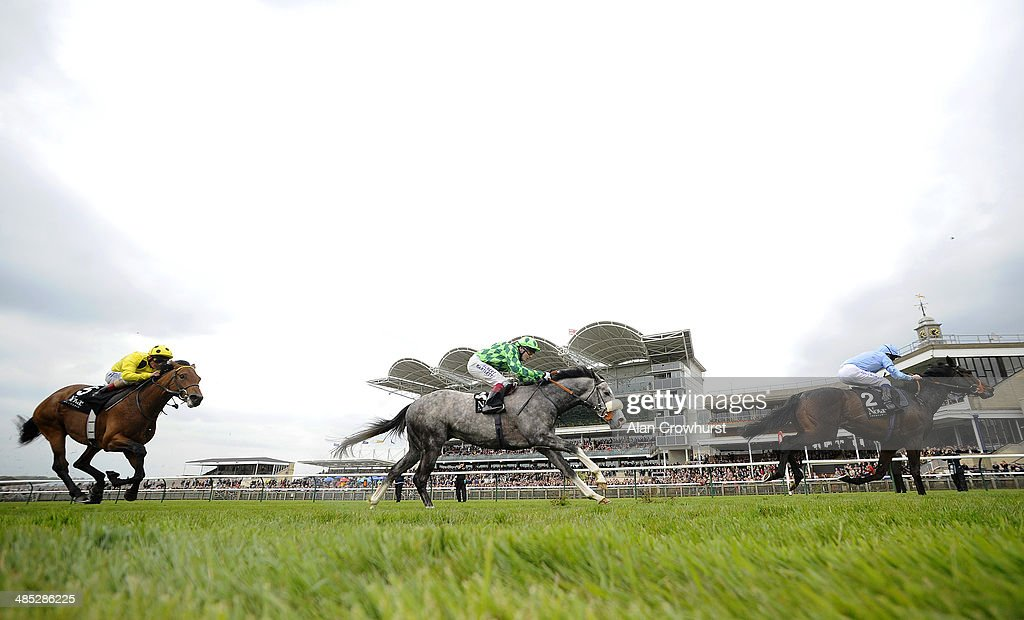 Ryan Moore riding Toormore win The Novae Bloodstock Insurance Craven Stakes at Newmarket racecourse on April 17 2014 in Newmarket England
