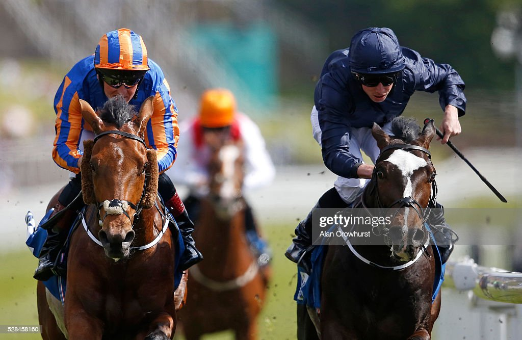 Ryan Moore riding US Army Ranger (R) win The MBNA Chester Vase from Port Douglas (L) at Chester racecourse on May 5, 2016 in Chester, England.