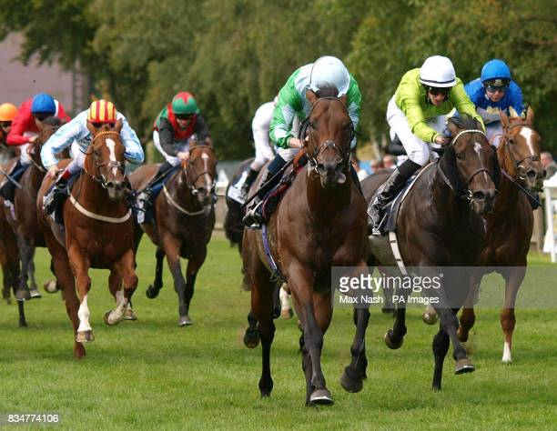 Ryan Moore takes Edge Closer past George Baker on Balthazaar's Gift to win The Countrywide Steel and Tubes Hopeful Stakes at Newmarket Racecourse