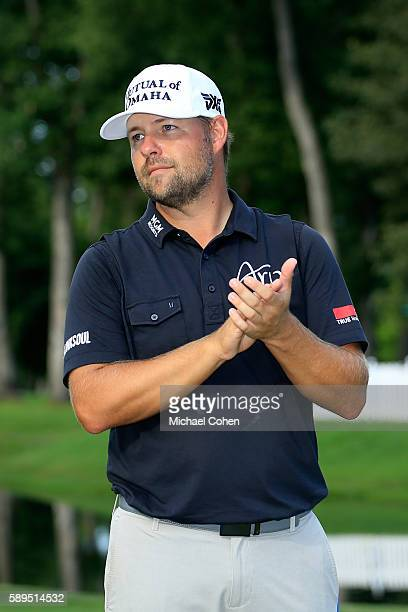 Ryan Moore waits to receive the trophy during the final round of the John Deere Classic at TPC Deere Run on August 14 2016 in Silvis Illinois