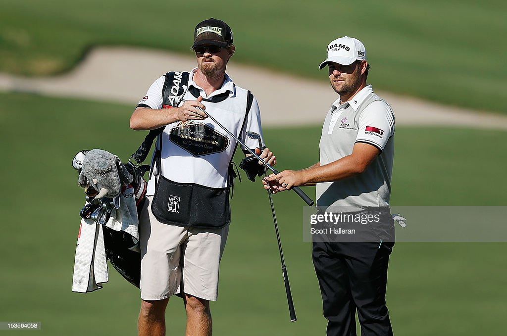 Ryan Moore waits with his caddie J.J. Jakovac on the 15th hole during the third round of the Justin Timberlake Shriners Hospitals for Children Open at TPC Summerlin on October 6, 2012 in Las Vegas, Nevada.