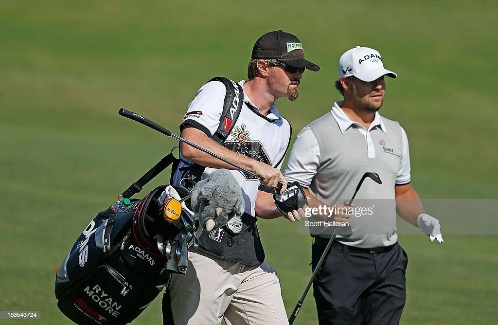 Ryan Moore walks with his caddie J.J. Jakovac on the first hole during the third round of the Justin Timberlake Shriners Hospitals for Children Open at TPC Summerlin on October 6, 2012 in Las Vegas, Nevada.