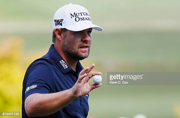 Ryan Moore waves to the gallery on the ninth green during the final round of the TOUR Championship at East Lake Golf Club on September 25 2016 in...