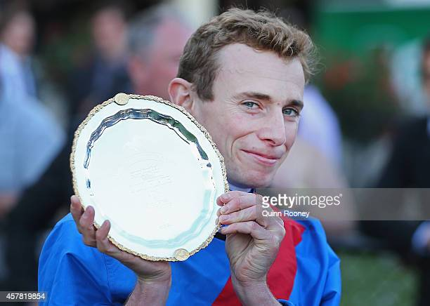 Ryan Moore who rode Adelaide poses with the Cox Plate after winning the Sportingbet Cox Plate during Cox Plate Day at Moonee Valley Racecourse on...