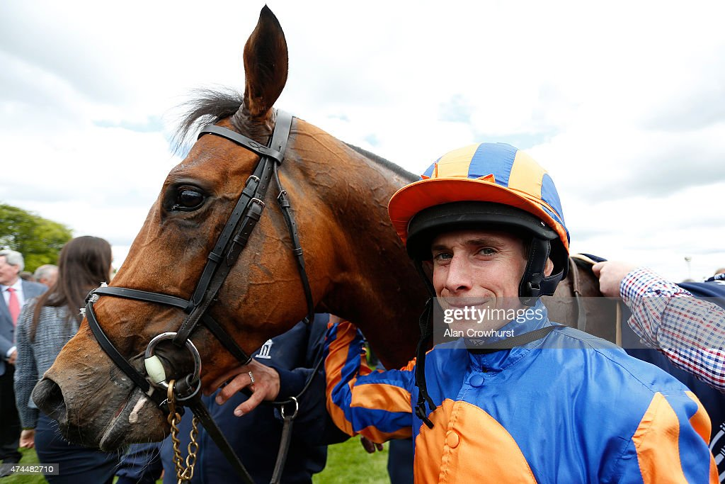 Ryan Moore with Gleneagles after winning The Tattersalls Irish 2000 Guineas at Curragh racecourse on May 23 2015 in Kildare Ireland