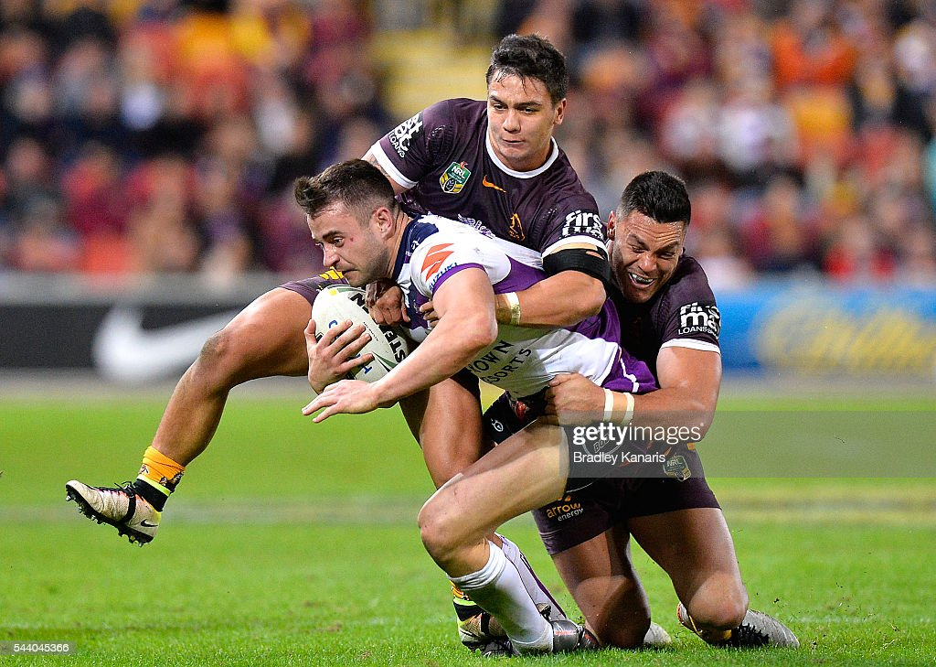 Ryan Morgan of the Storm attempts to break away from the defence during the round 17 NRL match between the Brisbane Broncos and the Melbourne Storm at Suncorp Stadium on July 1, 2016 in Brisbane, Australia.
