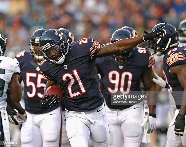 Ryan Mundy of the Chicago Bears celebrates an interception against the Philadelphia Eagles during a preseason game at Soldier Field on August 8 2014...