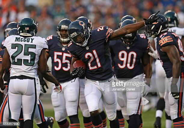 Ryan Mundy of the Chicago Bears celebrates his first quarter interception of a pass by Nick Foles of the Philadelphia Eagles during a preseason game...