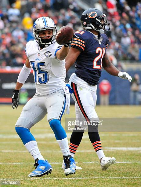 Ryan Mundy of the Chicago Bears walks by as Golden Tate of the Detroit Lions motions after making a first down during the second quarter at Soldier...