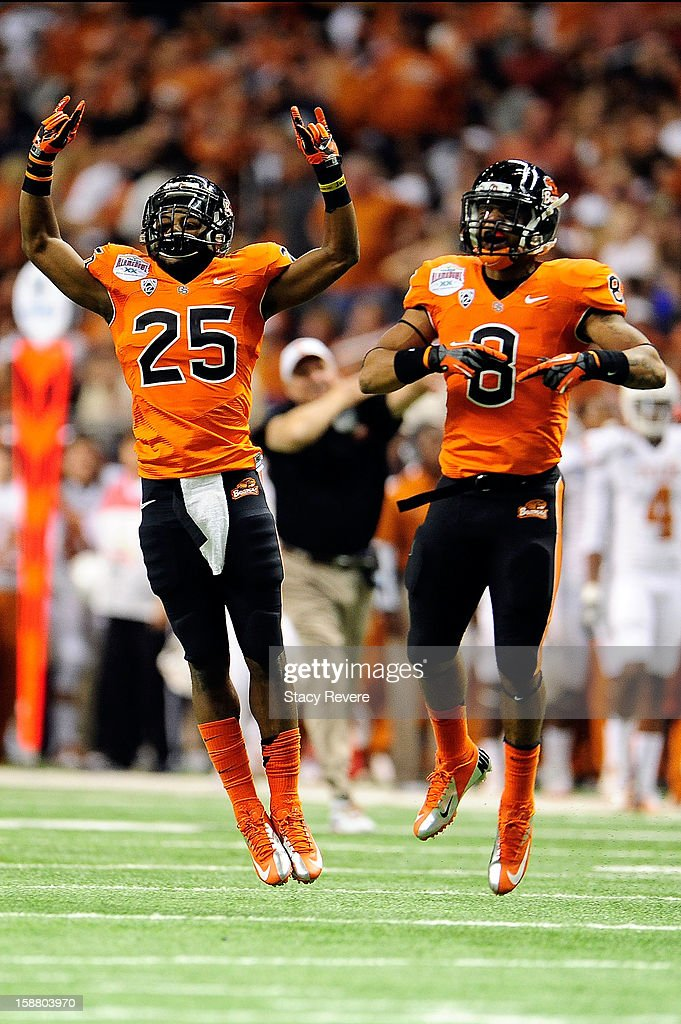 Ryan Murphy #25 and Tyrequek Zimmerman #8 of the Oregon State Beavers react to a stop against the University of Texas Longhorns during the Valero Alamo Bowl at the Alamodome on December 29, 2012 in San Antonio, Texas. Texas won the game 31-27.