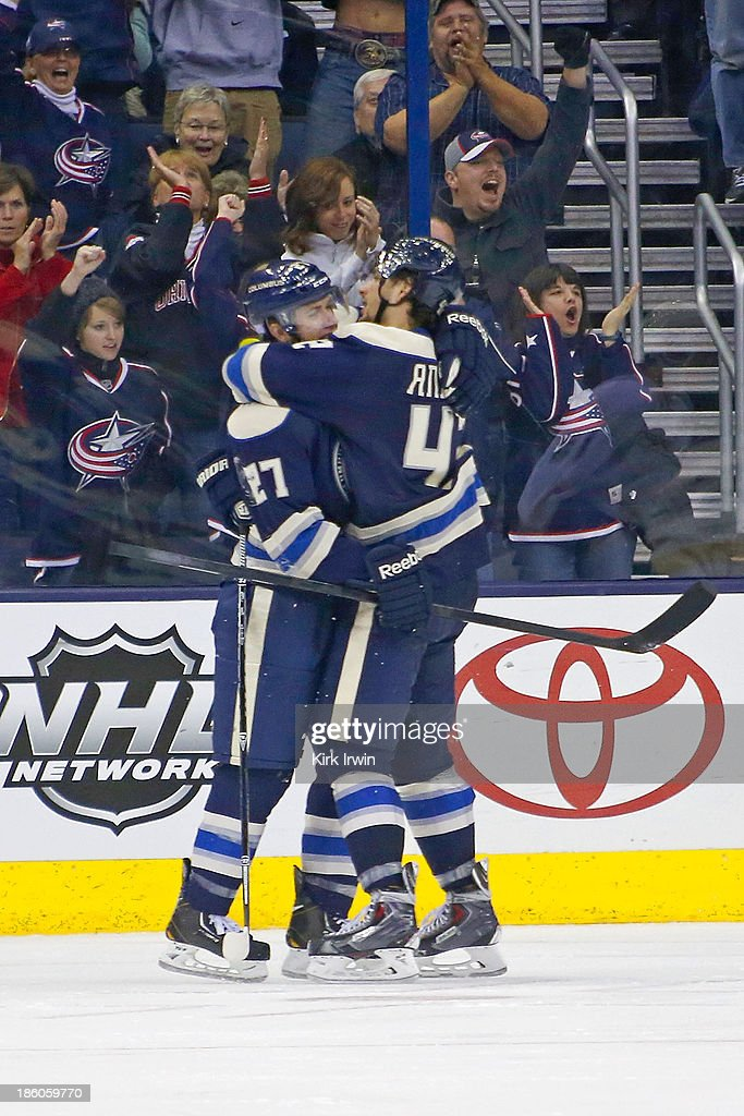 Ryan Murray #27 congratulates Artem Ansimov #42 of the Columbus Blue Jackets after scoring his second goal against the Anaheim Ducks during the third period on October 27, 2013 at Nationwide Arena in Columbus, Ohio. Anaheim defeated Columbus 4-3.
